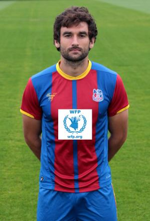 Joining the fight against hunger: Palace captain Mile Jedinak sports the WFP logo on his shirt