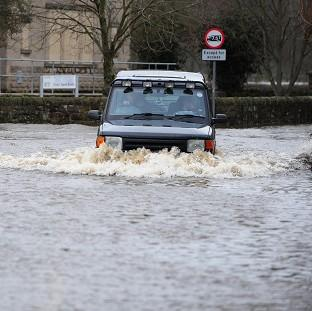 Flooding continues to hamper people trying to get home for Christmas