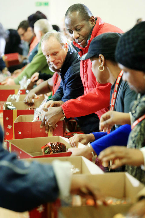 MP Mike Free helps pack Christmas hampers at Jesus House