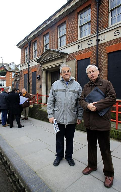 Derek Epstein and Gordon Massey in front of the Barnet Court House while planning committee members assessed the building this morning