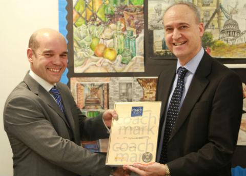 Headteacher Nick Christou at East Barnet School receives the Coachmark certificate from Will Thomas, co-director of Coachmark