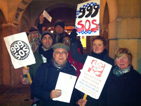 Mr Dismore and a handful of supporters waved placards outside the town hall before the meeting