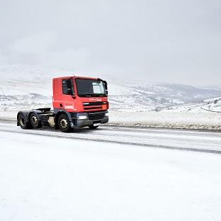 Traffic crosses the Brecon Beacons, South Wales, where snow is settling and even more has been forecast
