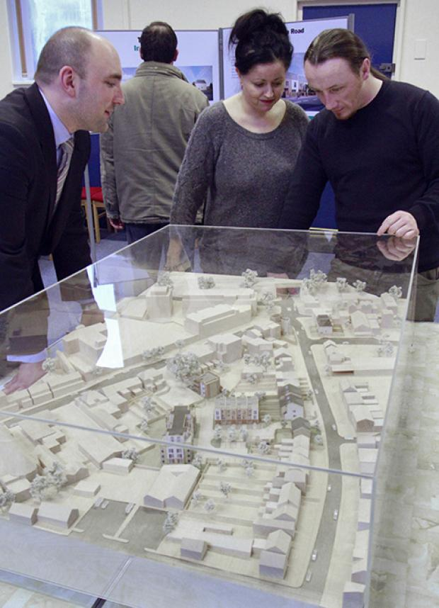 Spen Hill's Chris Hogwood shows the plans to the Builders Arms pub owners Elizabeth Brennan and James McLaughlin