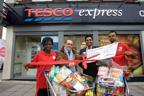 Neville Goldschneider officially opens Tesco Express with store manager Devang Patel and staff Rochelle and Indika