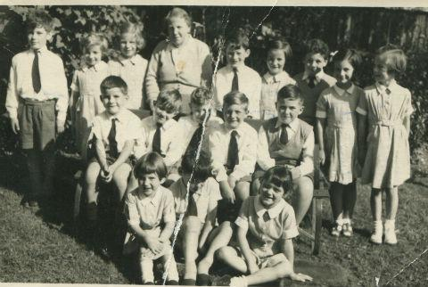 Times Series: Michael Kemp (top left) was eight years old when he posed with the rest of Form Three at the Friern Barnet Lane school