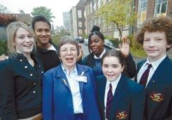 Examination results: Hendon school's associate headteacher, Jenny Pick (pictured with pupils), worked alongside Nick Christou, of East Barnet School, to drive up standards.