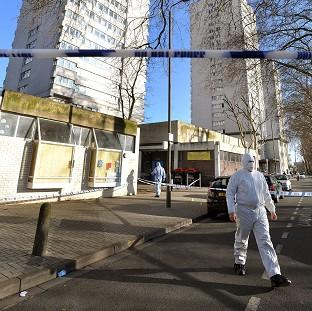 A police forensic officer outside Albon House in Wandsworth, south west London, where a 16-year-old boy was found stabbed to death on a stairwell