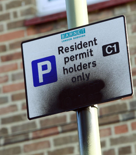 Resident permit holders only signs sprayed with black paint in Cricklewood