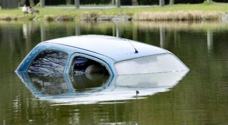 The driver, a mother, reversed into the Totteridge Lane fishing lake off a jetty at about 8am