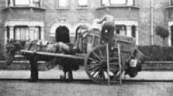 Wagon waste: the tip-up dustcart of yesteryear. A short ladder was needed and many dustmen wore a special leather hat and back flap