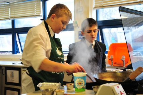 Pupils Michael Dent and Zaid Singer making their vegetarian curry