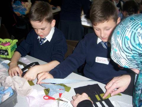 Schoolchildren learn how to weave Islamic prayer mats