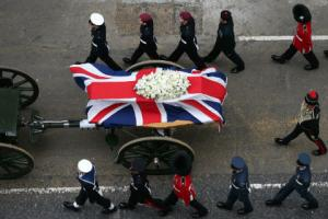 Thatcher funeral procession marked by cheers from supporters