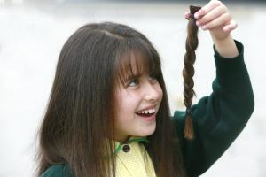 A girl from Mill Hill has shorn her lovely locks to raise money for children who have lost their hair.
