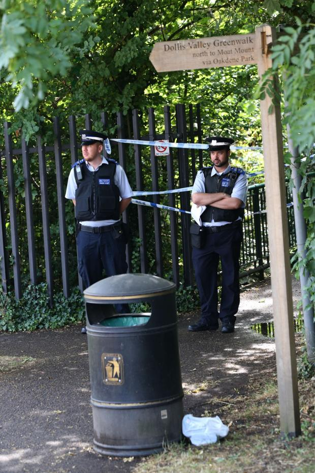 Times Series: Police cordon off the scene where Miss Kovacs's body was found.