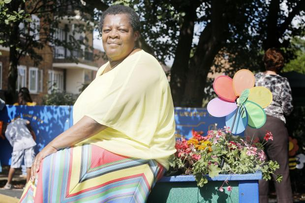Times Series: Selina Higgins in the Grange Estate garden dedicated to her brother Horace White.