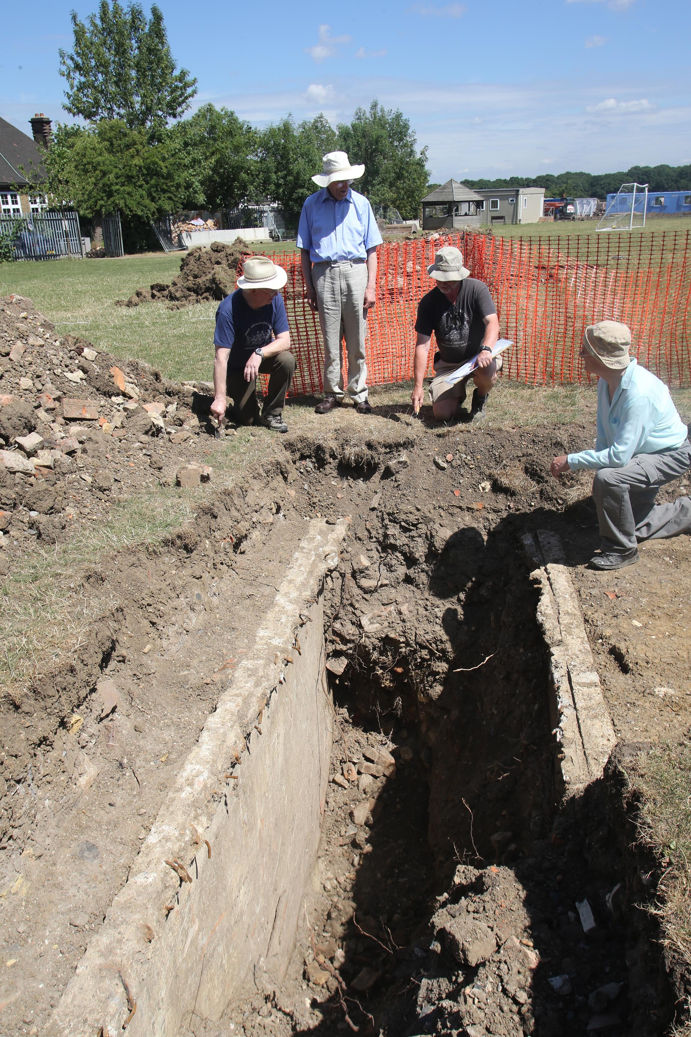 Members of the archaeological society puzzle over the bunker