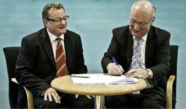 Times Series: Capita's group finance director Gordon Hurst and Barnet Council leader Richard Cornelius signing the customer services contract, worth £126 million