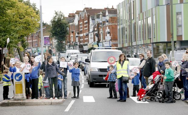 In October, parents rolled out a makeshift crossing on Colney Hatch Lane to raise awareness about the proposals