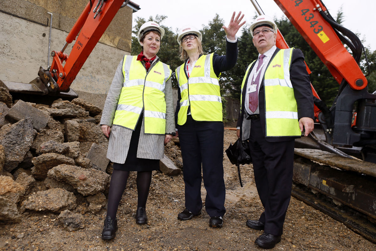 Barnet Homes chief executive Tracey Lees (left) at a recent building project. Barnet Council says it would cost £2.1million to build the 14 homes that were recovered