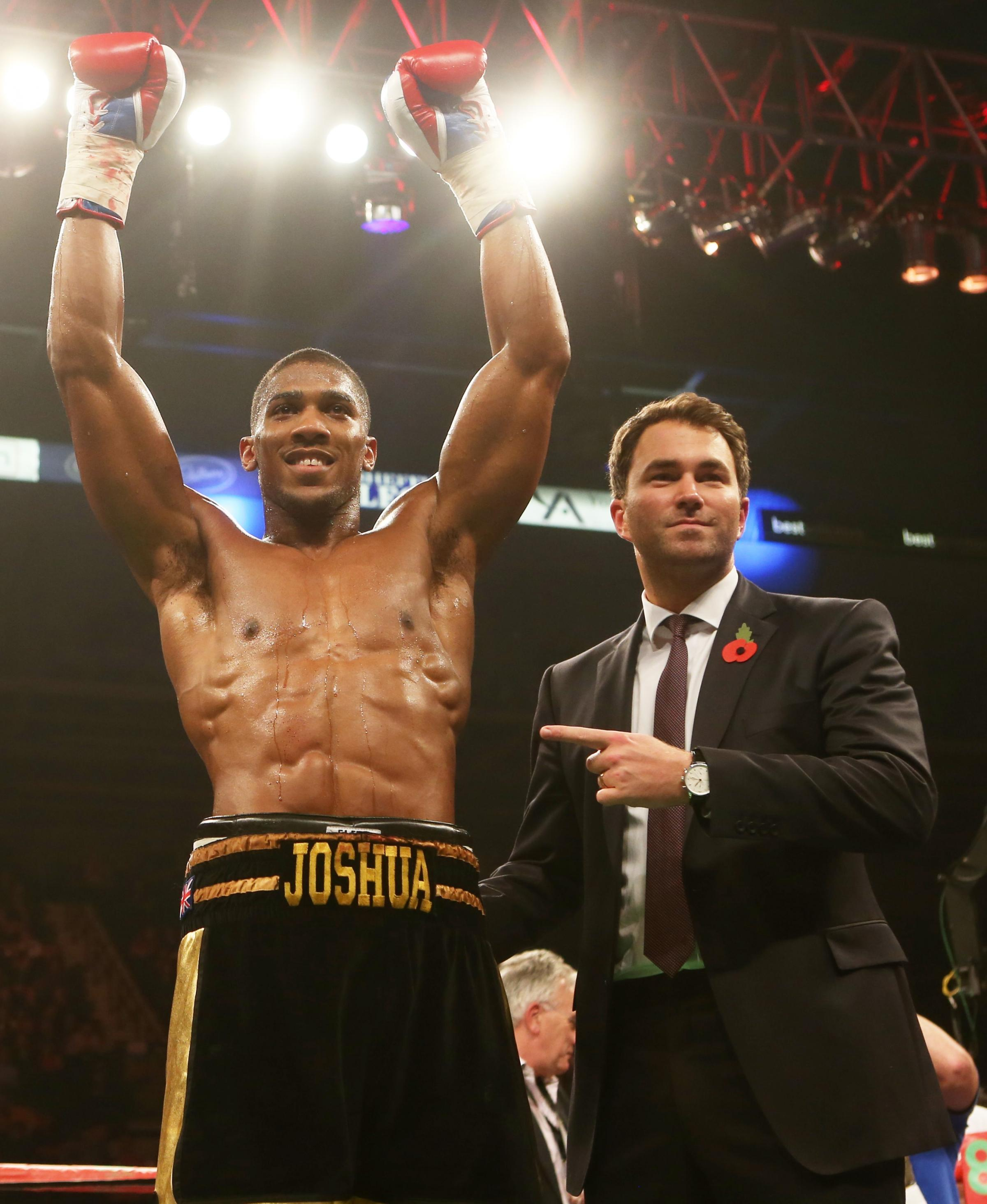 Anthony Joshua with his promoter Eddie Hearn after Saturday's win. Picture: Action Images