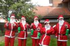 Hospice supporters can raise money by wearing a Santa suit for the day