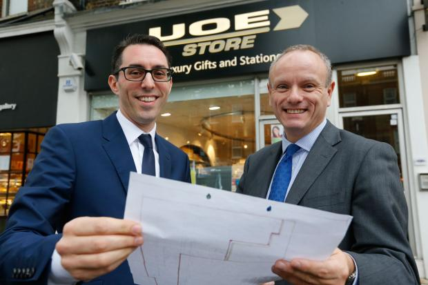 Elliot Jacobs, managing director of Universal Office Equipment, and MP Mike Free looking over the plans.