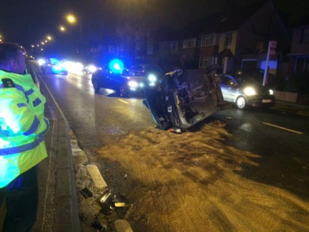 Two men were taken to hospital after one of the vehicles rolled over the central reservation