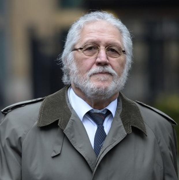 Times Series: Former DJ Dave Lee Travis arrives at Southwark Crown Court in London, where he is accused of a series of indecent assaults and one sexual assault