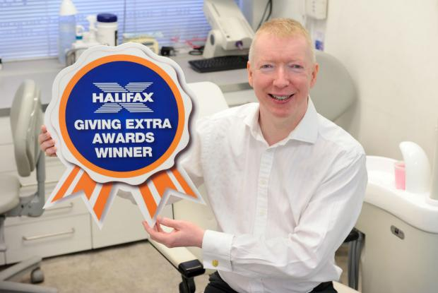 Dr Brian Doherty shows off his Halifax Giving Extra Award.