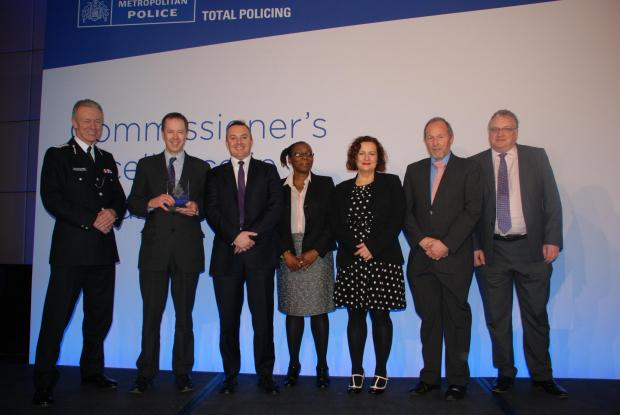 Times Series: Members of the trust and met police collecting their award