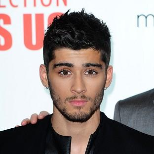 Zayn Malik's mother is perturbed by his tattoo collection.