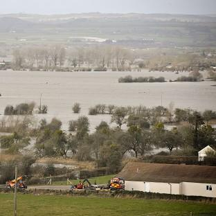 Times Series: Flood water covers part of the Somerset Levels near Burrowbridge