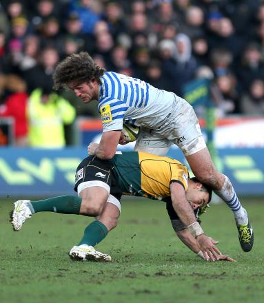 Jacques Burger (R) is tackled by Northampton Saints Kahn Fotuali'i. Picture: Action Images