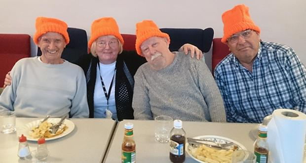 Bright orange hats add quirky twist to charity lunch
