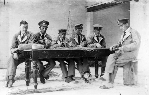 Private Percy Meek (far left) taught other recovering soldiers basket making during his stay at the hospital