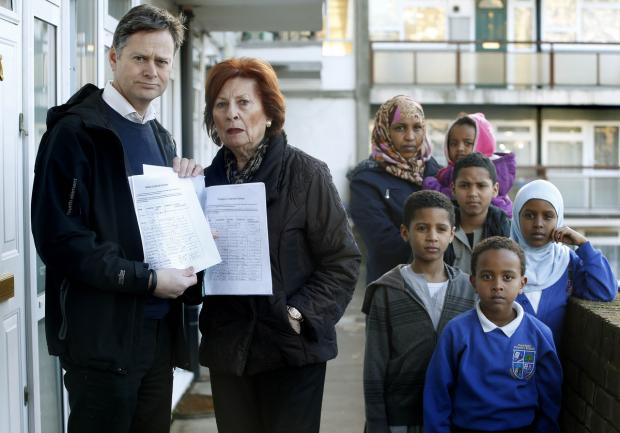 Hendon MP Matthew Offord with Shirley Pearl and other residents of the block who have signed the petition