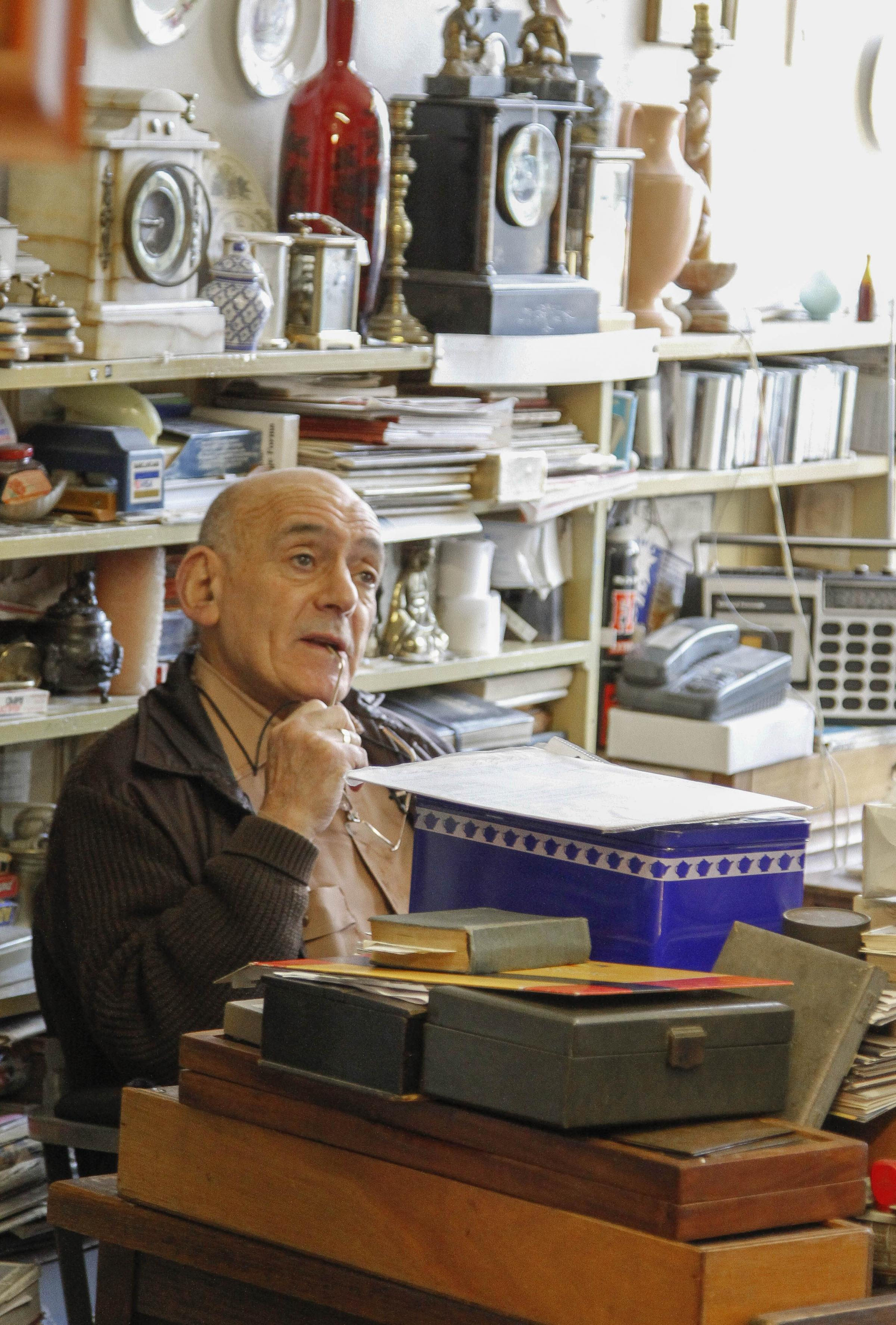 Sam Greenman in his antiques shop, Finchley Fine Art Galleries, which he ran for 35 years.