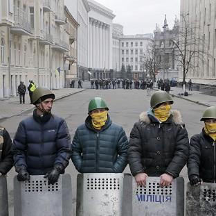 Times Series: Protesters guard the entrance to Ukrainian President Yanukovych's office in Kiev (AP)