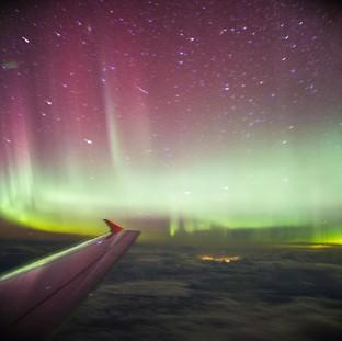 Times Series: A photo taken from a BA flight, chartered by Aerobility, a charity that gives people with disability the chance to fly, of the Northern Lights.