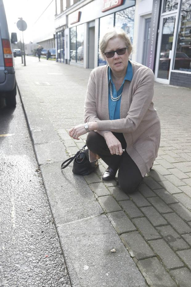 Times Series: Gil Exon standing near the dropped kerb where she was fined £110.