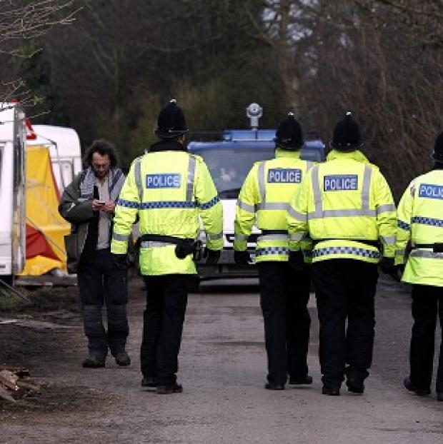 Times Series: Police patrol a private road in Barton Moss, Greater Manchester where anti-fracking protestors have set up camp