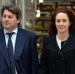 Former News International chief executive Rebekah Brooks and her husband Charlie Brooks arrive at the Old Bailey in London