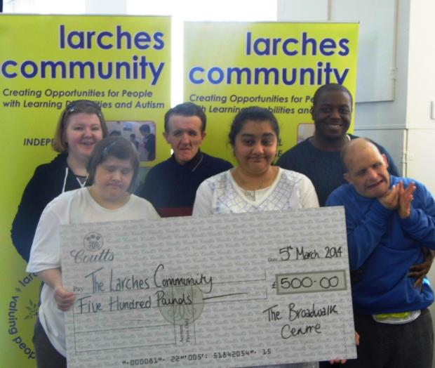 The Larches Community picks up their cheque for £500