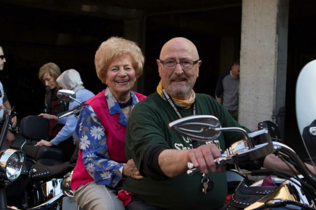 Members of Holocaust Survivors Centre have their photos taken with Jews on Bikes stars.