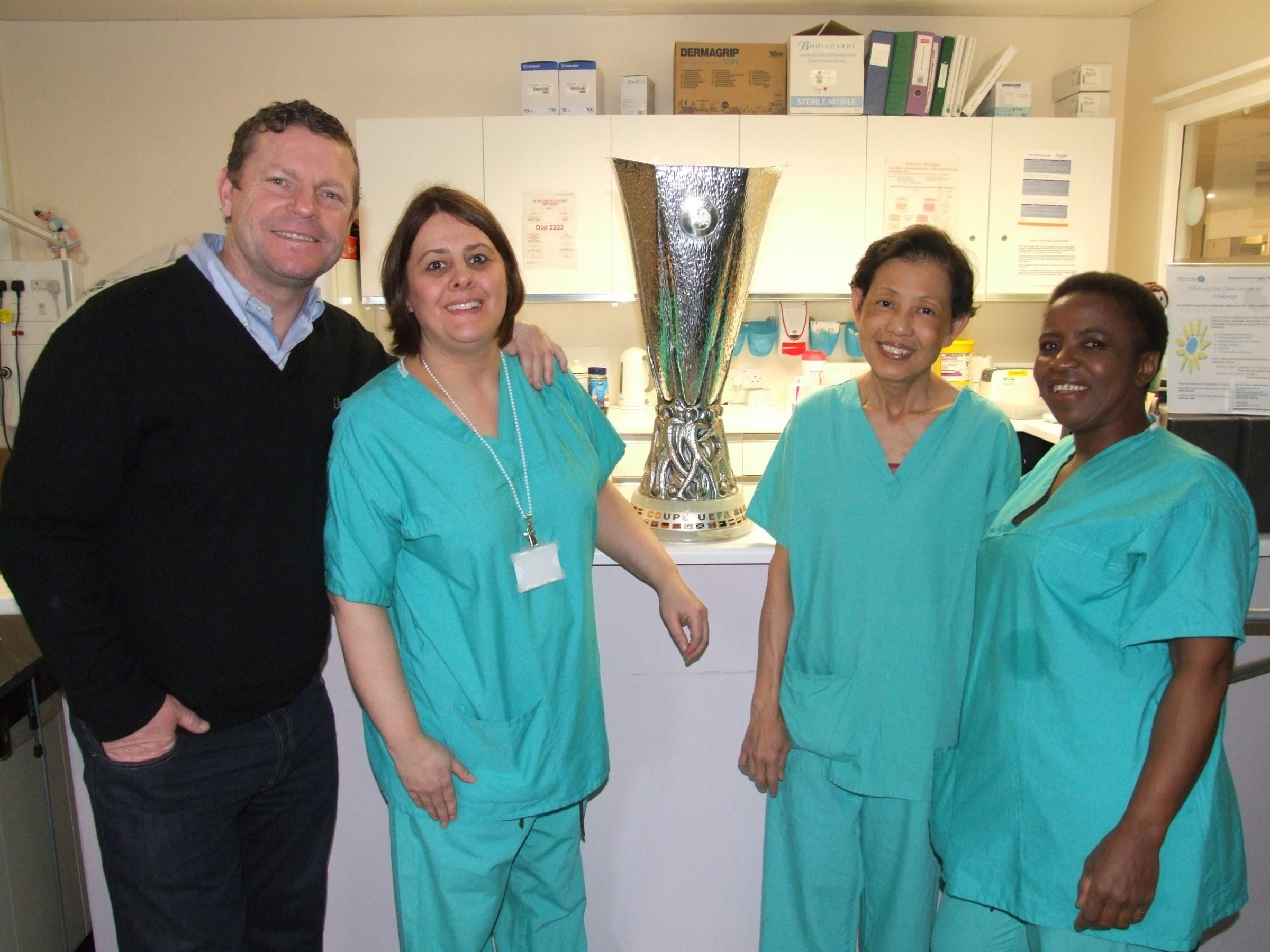 Staff and patients get their hands on famous football trophy