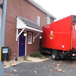 Times Series: A Royal Mail lorry crashed into the side of a house in Gosport