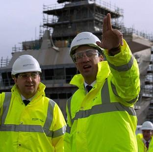 Labour leader Ed Miliband, right, visits Rosyth Dockyard in Fife