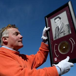 Jim Railton holds a rare strand of Elvis Presley's hair which will be sold at auction